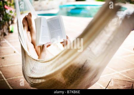 A woman asleep in a hammock - Stock Photo