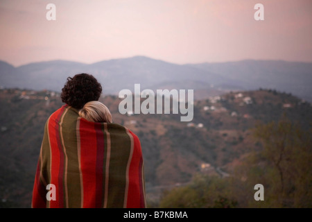 couple sharing a blanket