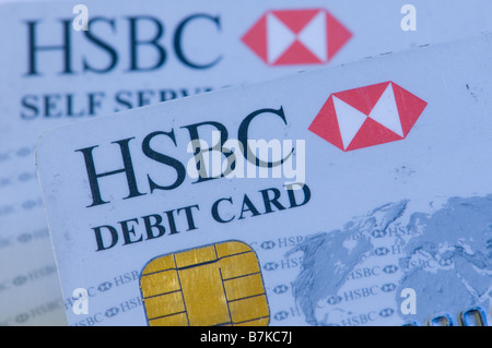 HSBC bank self service ATM and debit cards UK - Stock Photo