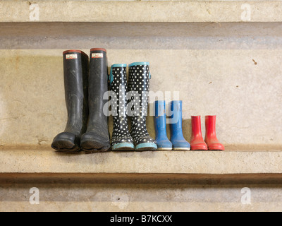 Four Pairs Of Wellington Boots - Stock Photo