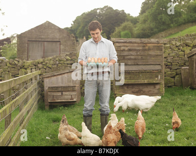 Farmer With Eggs, Hens And Geese - Stock Photo