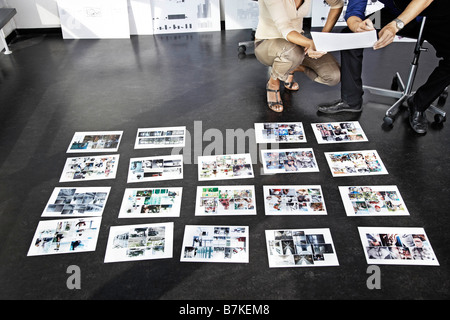 Coworkers concentrating on pictures - Stock Photo
