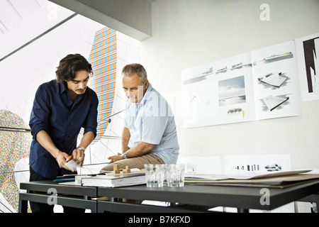 Architects working on a project - Stock Photo