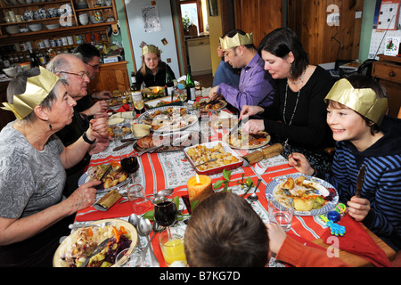 Family Christmas Dinner in a large family kitchen Cumbria UK Model Released - Stock Photo