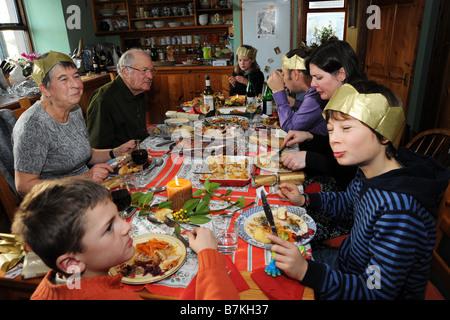 Family Christmas Dinner in a large family kitchen Cumbria UK - Stock Photo