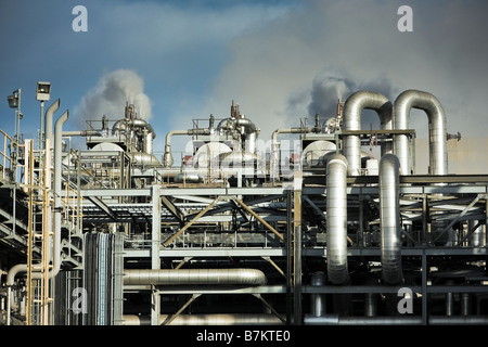 Maze of steel pipes and chimneys inside the facility at a modern gas fired power station plant, UK - Stock Photo