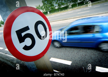 Cars on 50 mph limit road - Stock Photo