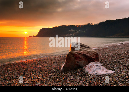 Sunrise from Little Oddicombe Beach in Torquay in South Devon England looking South along the coast - Stock Photo