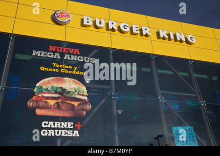 Billboard advertising Burger King in spanish in Juarez Mexico The economic boom experienced by border towns like - Stock Photo