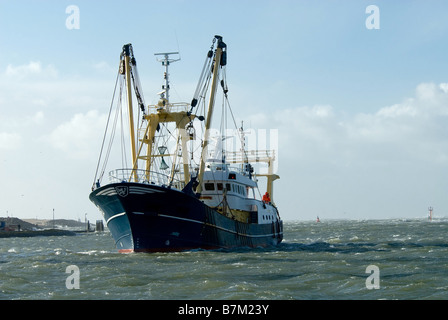 fishing ship during a storm in harbor IJmuiden Holland The Netherlands - Stock Photo