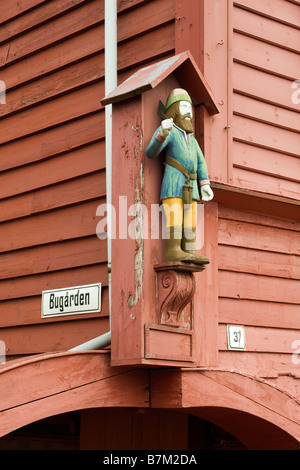 Detail of wooden carving at Bryggen, historic Hanseatic commercial buildings in Bergen, Norway - Stock Photo
