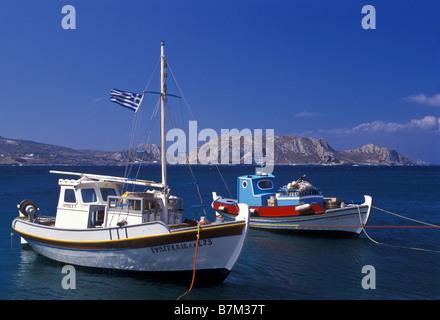 Fishing boats float at anchor, Finiki, Karpathos, Greece. - Stock Photo