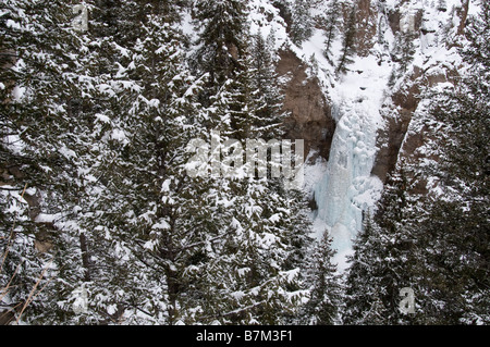 Tower Falls in winter, Yellowstone National Park, Wyoming. - Stock Photo