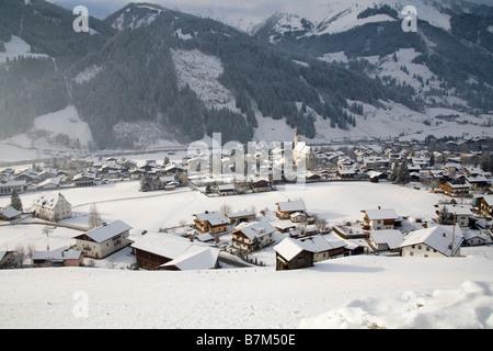 Rauris Austria EU January View down on this ski resort town as the sunshine spreads along the Rauriser Sonnen Valley - Stock Photo