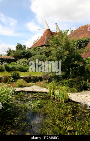 A DECORATIVE WILDLIFE POND IN AN ENGLISH COUNTRY GARDEN. - Stock Photo