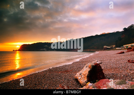 Sunrise from Oddicombe Beach in Torquay in South Devon England looking South along the coast - Stock Photo