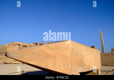 Fallen Obelisk in the Temple of Karnak near Luxor in Egypt caused by an Earthquake - Stock Photo