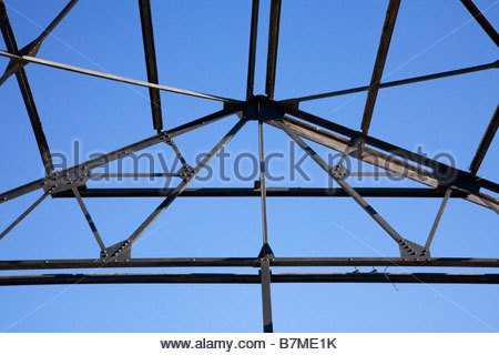 Steel frame outlined against blue sky some wood - Stock Photo
