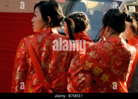 Paris France, Chinese Women in Traditional Fancy Dress Parading in 'Chinese new year' Carnival in Street, From Rear, - Stock Photo