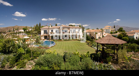 Newly constructed large villa in the hills in southern Spain with swimming pool and garden with lawn - Stock Photo