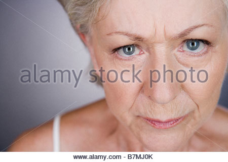 A senior woman looking angry - Stock Photo