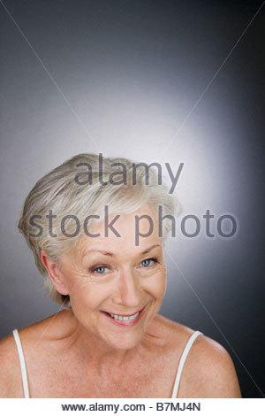 A senior woman smiling - Stock Photo