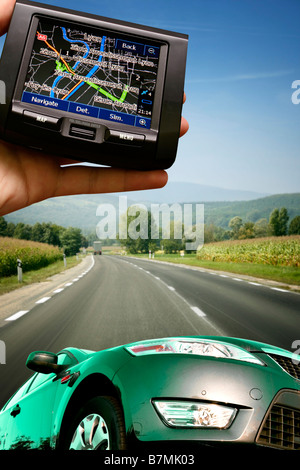 great car on the highway gps in a man hand - Stock Photo