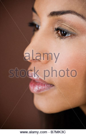 A portrait of a young woman looking thoughtful - Stock Photo