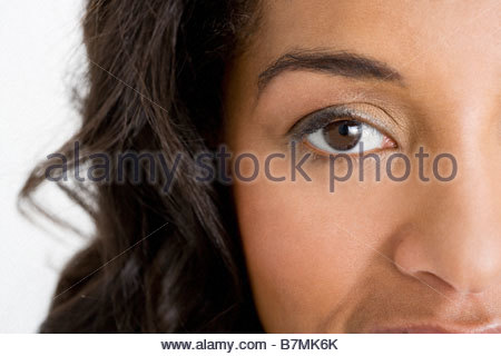 Close of a woman's face, showing her eye - Stock Photo
