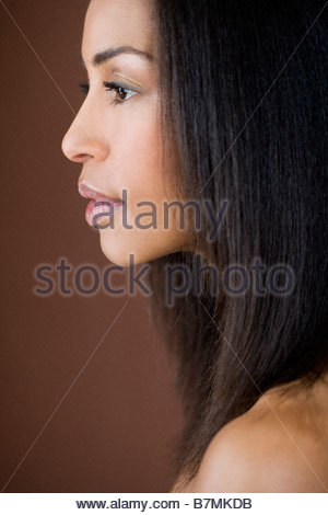 A portrait of a young woman, side view - Stock Photo