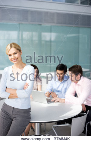 A female business project leader at team meeting - Stock Photo