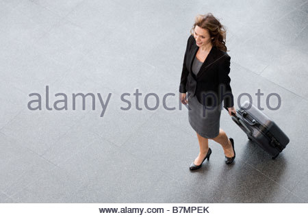 A businesswoman and suitcase - Stock Photo