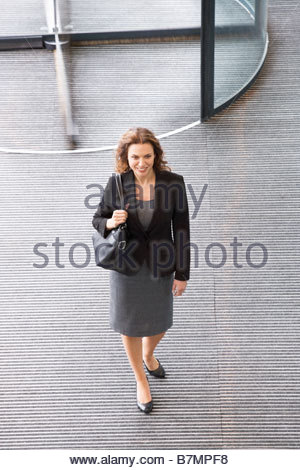 A businessman arriving at work - Stock Photo
