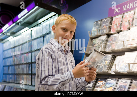 Teenage Boy in Computer Game Shop   Stock Photo. teenage boy in a computer game shop in London Stock Photo  Royalty