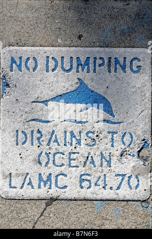 No dumping sign trying to prevent dumping of rubbish in drains help the ocean sea dolphin pacific los angeles california - Stock Photo