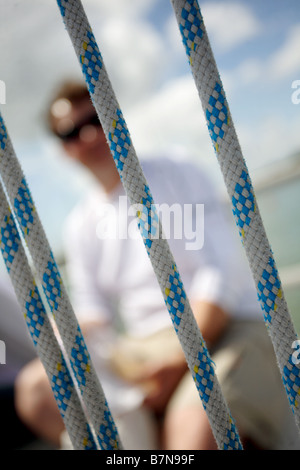 white,european sailor, sailing a Yacht on the Solent,UK. - Stock Photo