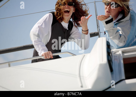 2 female sailors having fun on a Yacht - Stock Photo