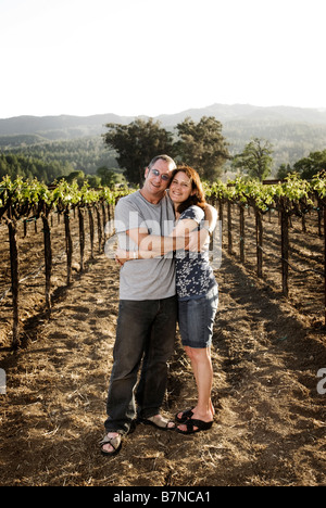 couple hugging in california vineyard