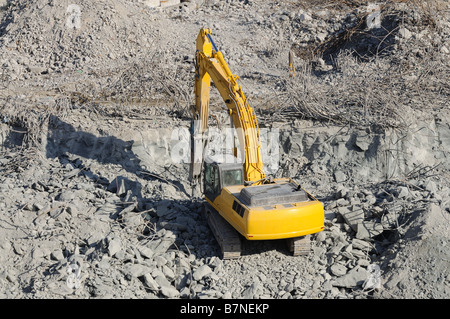 Yellow excavator at a construction site - Stock Photo