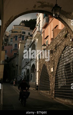 Narrow street in the town of Amalfi in Campania, Italy. Amalfi and  its coast has been inscribed on UNESCO World - Stock Photo