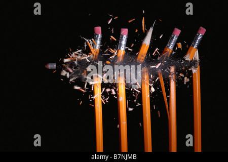 A bullet hitting pencils - Stock Photo