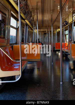 Empty seats in a largely empty subway car on the W train line servicing Brooklyn and Queens in New York City. - Stock Photo