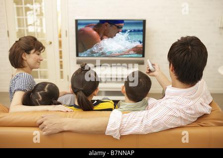 Family watching TV - Stock Photo