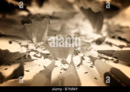 Sharpened pencil and wood shavings - Stock Photo