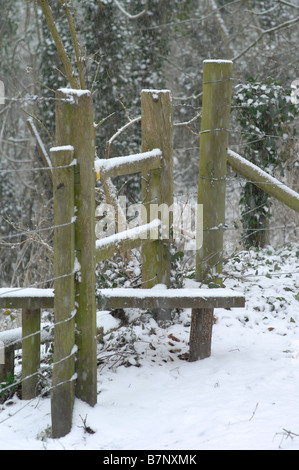 Stile in a heavy snowfall in February in Kent - Stock Photo