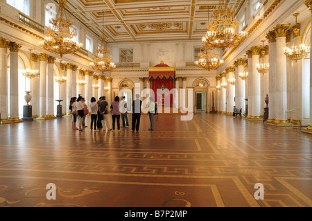People in the St George (Large Throne) Hall in Winter Palace, St. Petersburg, Russia - Stock Photo