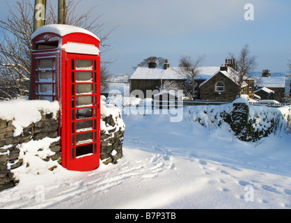 Red Telephone Box in Oldfield near Holmfirth during the February 2009 snowfalls, West Yorkshire, England, United - Stock Photo