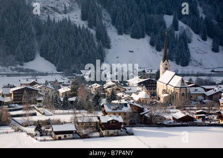 Rauris Austria Europe Alpine village and church in Austrian Alps with snow in Rauriser Sonnen Valley in winter - Stock Photo