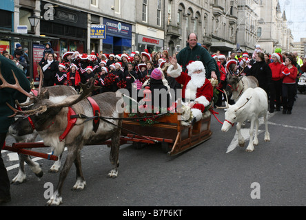 Santa claus and his reindeer parade along Union Street in Aberdeen, Scotland, Uk before Christmas. - Stock Photo