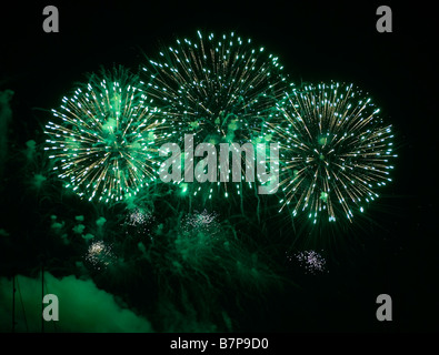 Fireworks exploding with green colors - Stock Photo